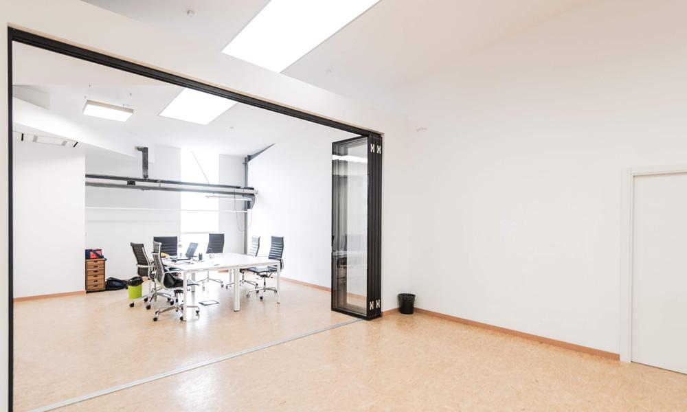Glazed sliding movable wall