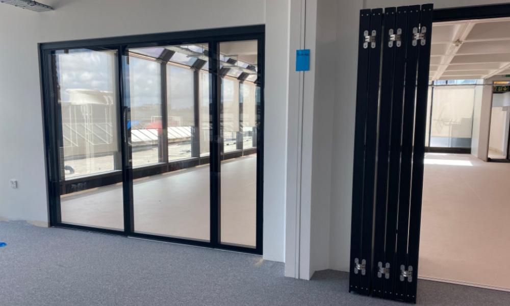 Glazed sliding wall system